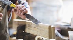 Carpenter with chisel working at workshop Stock Footage