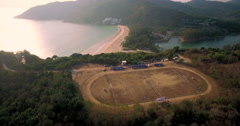 Soccer Game On Football Pitch Overlooking Naiharn Beach Phuket Wraparound  Shot Stock Footage