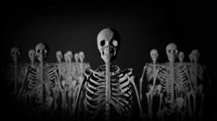 Group of Skeletons Standing in the Dark staring at the Camera in a Creepy Look Stock Footage