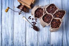 Jute bags with coffee beans and grinder - stock photo