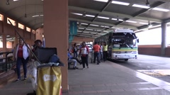 People disembarking from a bus in the Panama National Terminal Stock Footage