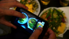Taking making food photo via smart phone in a dark restaurant for social media Stock Footage