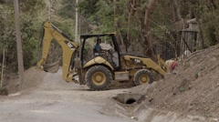 Backhoe Loading Personal Effects of Flood Victims Stock Footage