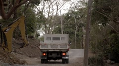 Man Parks Dump Truck and Steps Out Stock Footage