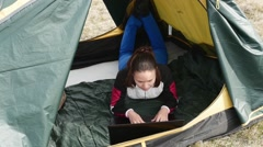 Tourist working with laptop in tent Stock Footage