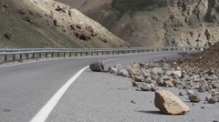 Rockfall on a mountain road Stock Footage