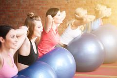 Pretty fit girls are exercising in group - stock photo