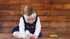 Little girl playing with color toys - stock footage