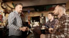 Best friends having fun watching football and drinking beer in pub 4K UHD video - stock footage