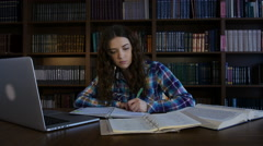 A student preparing for the exam in the library. 4K Stock Footage