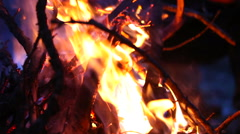 A man warms his hands by the fire Stock Footage