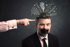 Leader pointing at employee - stock photo