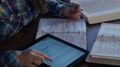 A student looking for information on the tablet. Preparing for the exams. 4K - stock footage