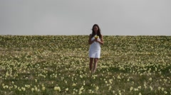 Yellow flowers and young lady Stock Footage