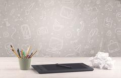 Design office desk with drawings background - stock photo