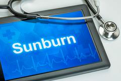 Tablet with the diagnosis Sunburn on the display Stock Photos