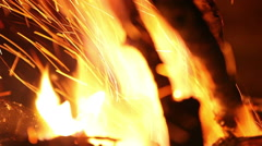 Bonfire close up. Put wood on the fire. Fire flames. No color correction - stock footage