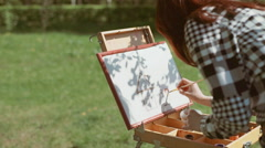 Girl draws on nature Stock Footage