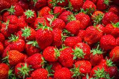 Background from fresh ripe strawberries, macro photography Stock Photos
