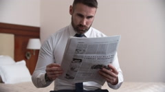 Reading Financial Newspaper - stock footage