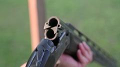 Man inserts Shotgun shells Stock Footage