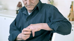 Widower seated while touches his wedding ring Stock Footage