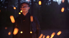 SLOWMOTION. Camping night couple cook by campfire backpack Arkistovideo