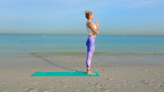 Woman do yoga still asana on the beach Stock Footage