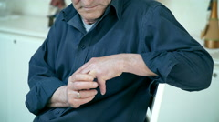 Detail of widower while touches sweetly his marriage ring Stock Footage