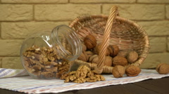 Walnut in basket and walnuts kernels on old wooden table Stock Footage