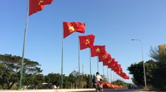 Timelapse view of vawing flags at highway in Vietnam Stock Footage