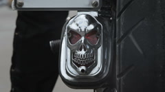 Biker on a motorcycle with a skull starts moving Stock Footage