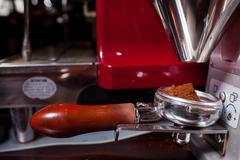 Coffeemachine pouring grind coffee. Close up. - stock photo