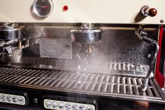 Coffee machine pouring hot water and cleaning itself. Close up. - stock photo