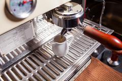 Coffee machine pouring hot coffee into porcelain mug. Close up. Stock Photos
