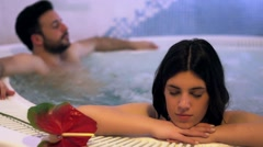 Romantic couple in Jacuzzi. - stock footage