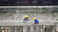 Chinese workers are building a dam - stock footage