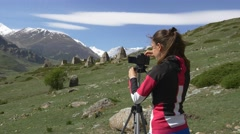 Female photographer and the ruins in the mountains Stock Footage