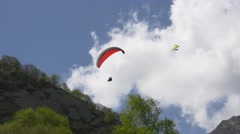 Red paraglider tandem Stock Footage