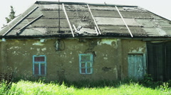 View of the exterior of the old dilapidated single-storey private house. Stock Footage