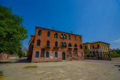 MURANO, ITALY - JUNE 16, 2015: Nice and pinturesque orange house in a street of Stock Photos