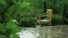 The inner courtyard of a modern rural house. Wooden terrace in the rain. Stock Footage