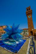 MURANO, ITALY - JUNE 16, 2015: Blue star sculpture made by glass on the center Stock Photos