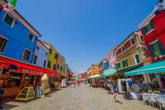 BURANO, ITALY - JUNE 14, 2015: Shop street at Burano, pinturesque neighborhood Stock Photos