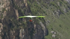 Green hangglider in the mountains Stock Footage