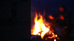 Man is heated by the fire - stock footage