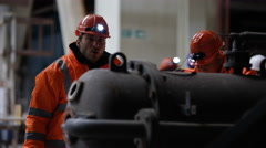 4K Engineers in power station carrying out maintenance & checking the machinery Stock Footage