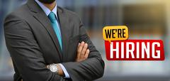 Professional with We are hiring Sign Banner - stock photo