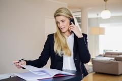 Business woman working from home Stock Photos