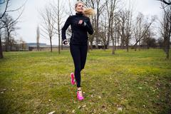 blonde woman running in park - stock photo